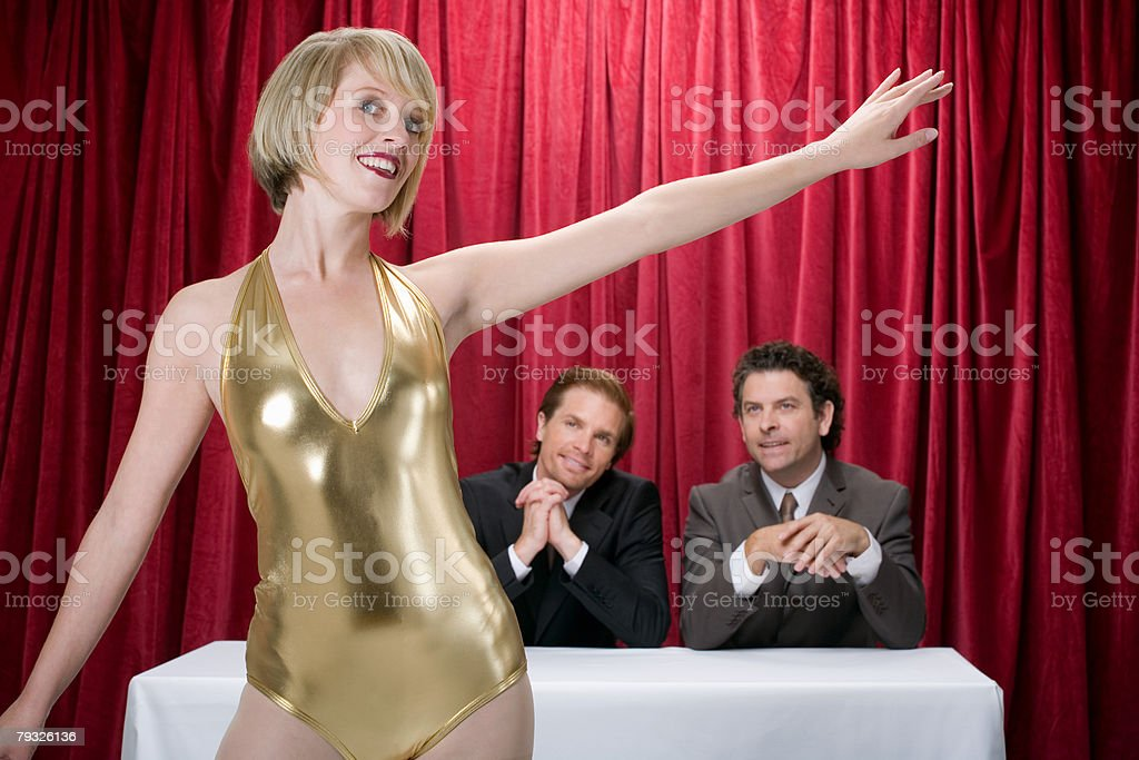 Woman performing for judges 免版稅 stock photo