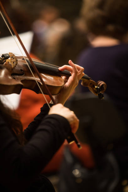 Woman performing on a violin stock photo