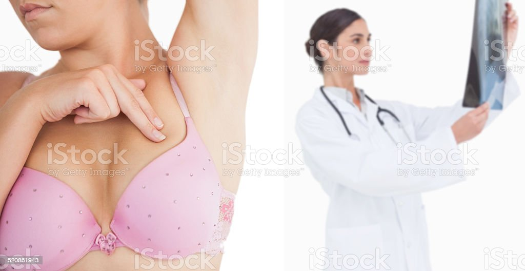 Woman performing self breast examination stock photo