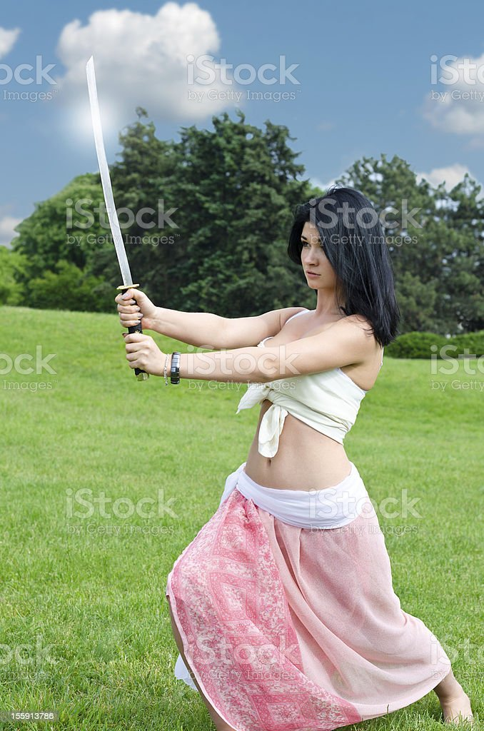 Woman performing with a sword stock photo