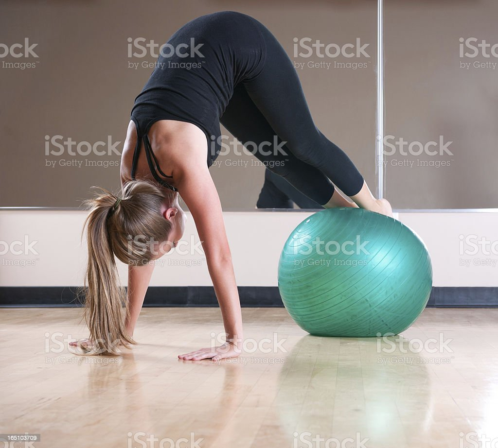 Woman Performs Ab Exercises with Exercise Ball stock photo