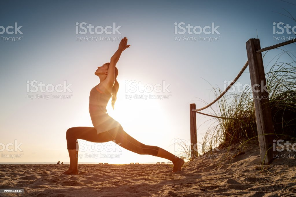 Woman performs exercises stock photo