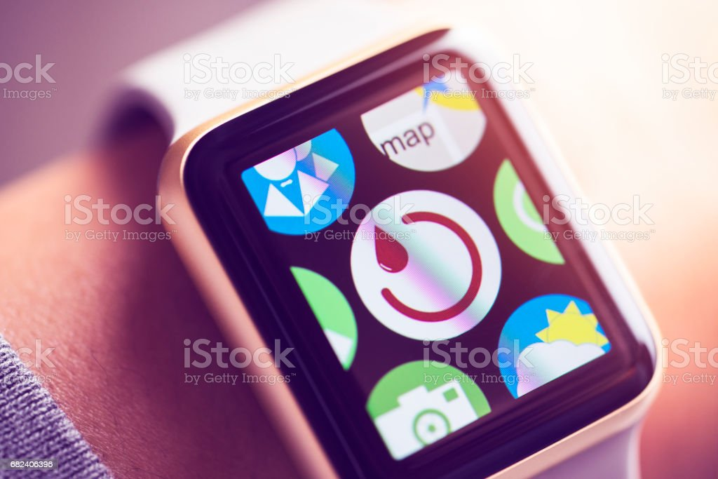 Woman period tracker app icon on smart watch screen. royalty-free stock photo