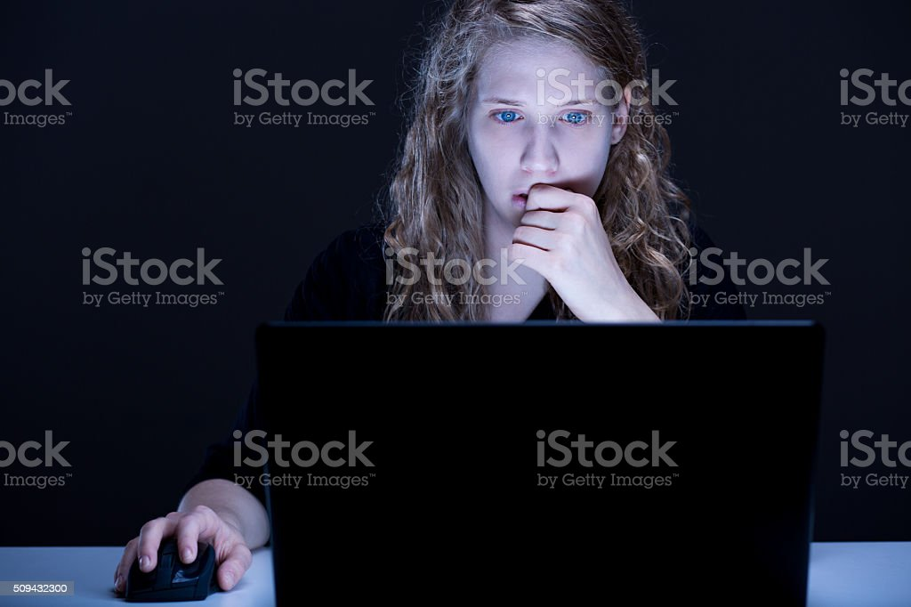 Woman persecuted on internet stock photo