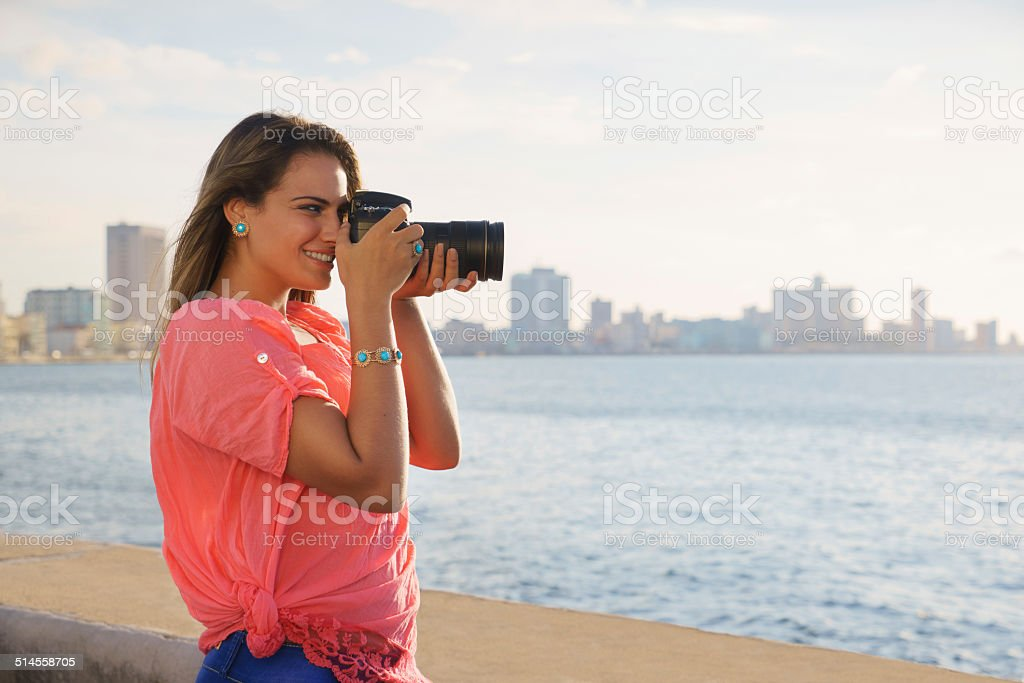 Woman photographer camera tourist picture photo stock photo