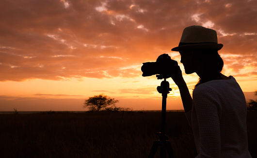 Woman photographer in nature setting