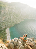 Woman photographer looking at scenic view  of Mediterranean coast in Turkey