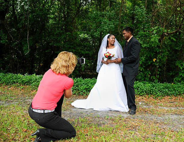 Woman photographer photographing diverse wedding couple picture id121119254?b=1&k=6&m=121119254&s=612x612&w=0&h=yntaolcawmydlg9pduzu62rlcmkny8rjjn5buxslaac=