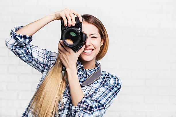 Woman photographer with camera picture id510237542?b=1&k=6&m=510237542&s=612x612&w=0&h=yq js ldnj2ray50sgsvspnsy8dhvifnxbq3glrruyy=