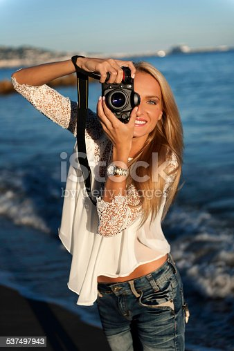 istock Woman photographer with camera 537497943