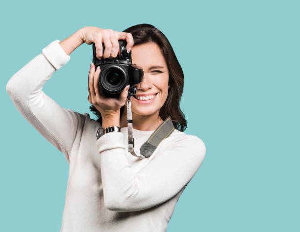 Woman photographer with dslr camera stock photo