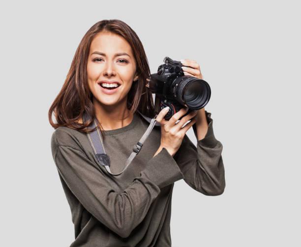 Woman photographer with dslr camera picture id641762316?b=1&k=6&m=641762316&s=612x612&w=0&h=chclr5 ko1oyri nk9fjbzurusw1ep3dubdbwfokqrs=