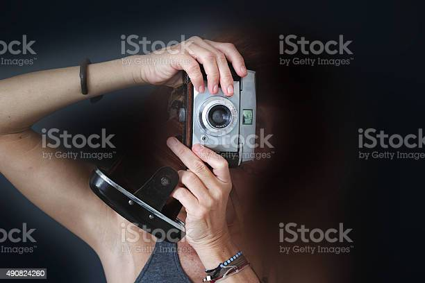 Woman photographer with old analog camera black background picture id490824260?b=1&k=6&m=490824260&s=612x612&h=5g0czhfpquaoesnr5h9r2192i341ralldd 0j0 x0ik=
