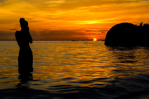 woman photographing a great sunset