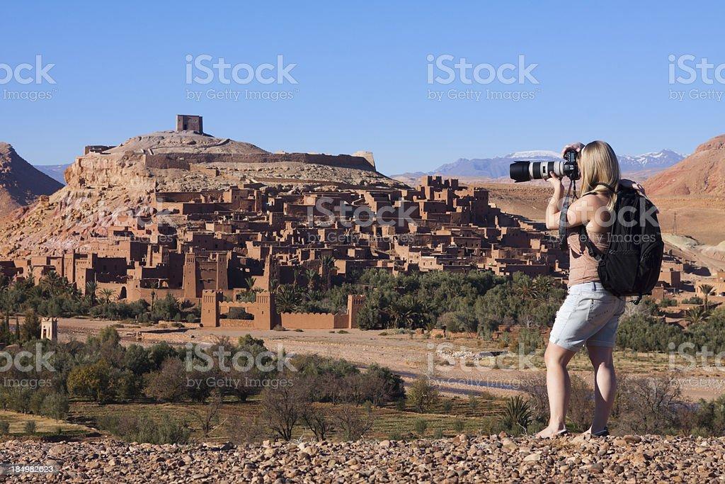 Woman Photographing Ait Benhaddou stock photo