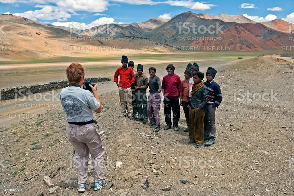 Woman Photographing Indian Men on More Plains India royalty-free stock photo