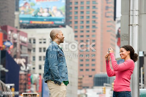 458128003 istock photo Woman photographing man 533906139