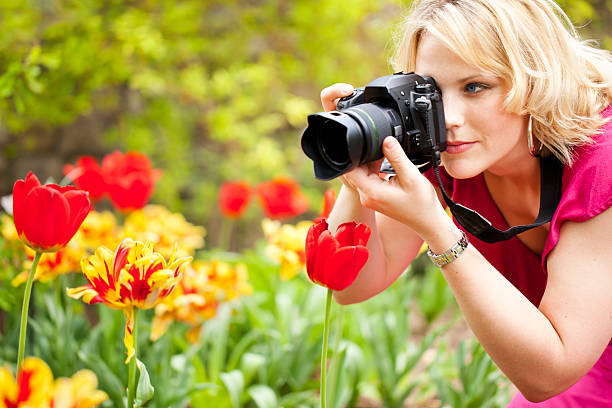 Woman photographing red tulips at close range with camera picture id133918929?b=1&k=6&m=133918929&s=612x612&w=0&h=o3uat4qrwigyrxtvbjsqzduuigglpfmiuaye5kys  g=