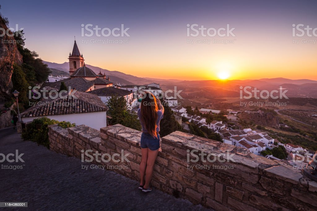 Woman photographing sunset from Zahara de la Sierra in Spain - Royalty-free Adult Stock Photo