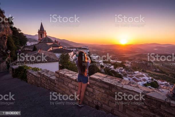 Woman photographing sunset from zahara de la sierra in spain picture id1184060001?b=1&k=6&m=1184060001&s=612x612&h=haowdz a74vjdhs8jagcwryt6p5whqp1bzrk7 m wh8=