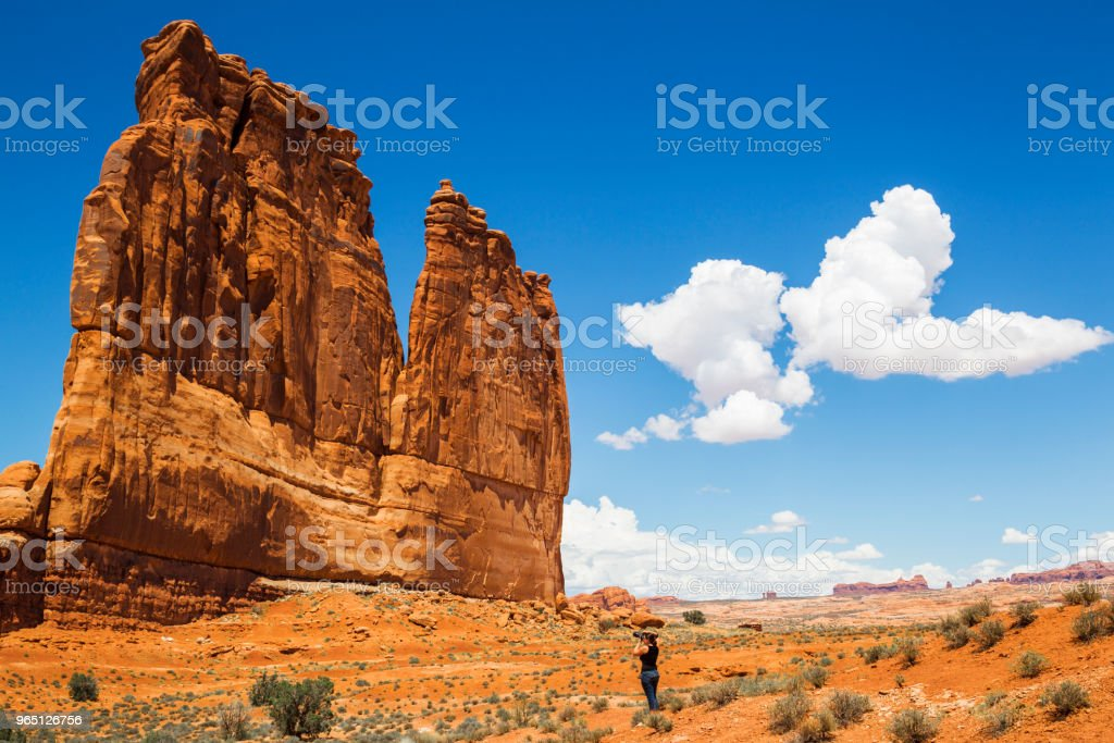 Woman photographing the Courthouse Towers in Arches National Park, Utah, USA royalty-free stock photo