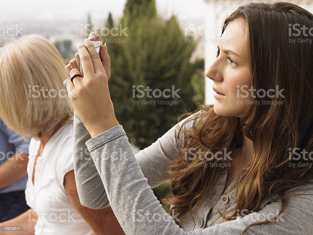 Woman photographing with a digital camera royalty-free stock photo