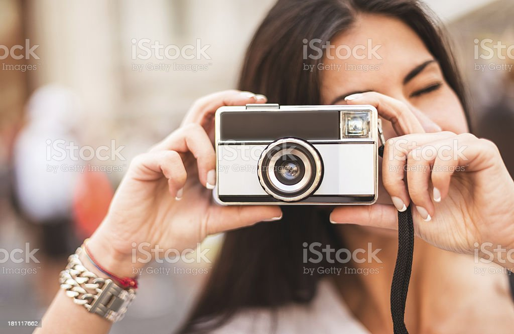 Woman photographing with vintage camera royalty-free stock photo