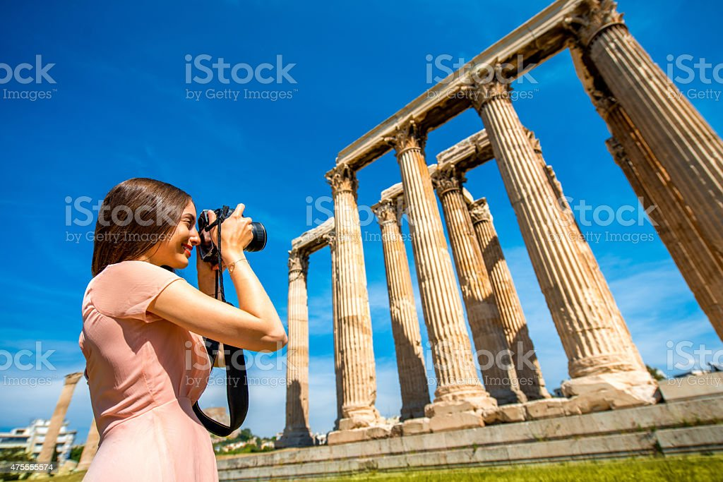 Woman photographing Zeus temple in Acropolis stock photo
