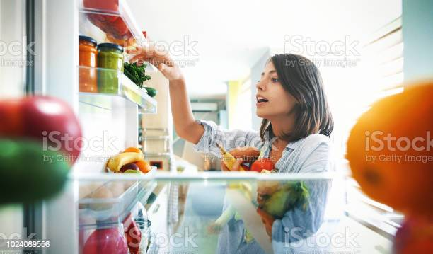 Woman picking up some fruits and veggies from the fridge picture id1024069556?b=1&k=6&m=1024069556&s=612x612&h=ddyc lqw i slnxcuvi2l8eujlpxpifxs31jexijp7a=