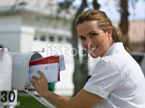istock Woman picking up the mail 157404327