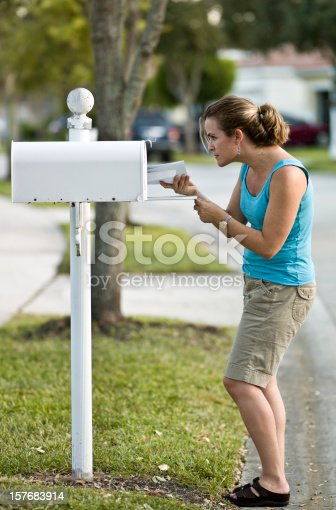 istock Woman picking up the mail 157683914