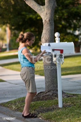 istock Woman picking up the mail 157683947