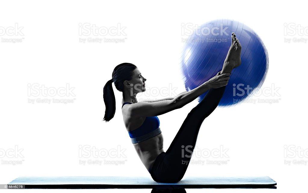 woman pilates ball exercises fitness isolated stock photo