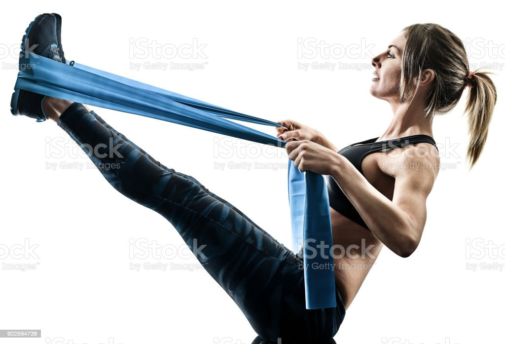woman pilates fitness elastic resistant band exercises silhouett stock photo
