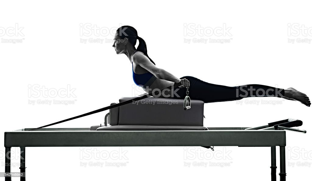 woman pilates reformer exercises fitness isolated stock photo
