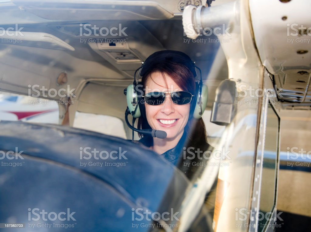 Woman Pilot in an Airplane stock photo