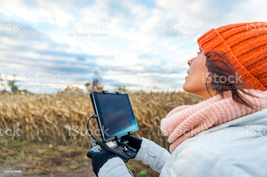 Woman Pilot Using Drone Remote Controller with a Tablet Mount stock photo
