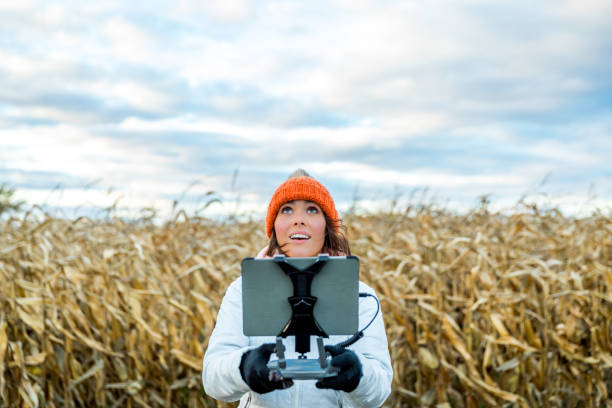 Woman Pilot Using Drone Remote Controller with a Tablet Mount Woman Pilot Using Drone Remote Controller with a Tablet Mount drone point of view stock pictures, royalty-free photos & images