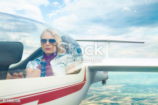 Woman piloting a glider.