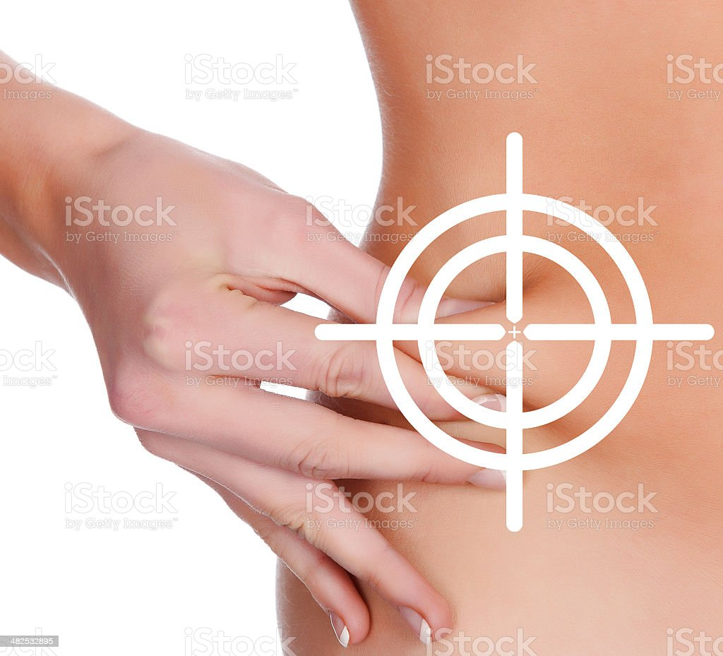 Woman pinches fat on her belly stock photo