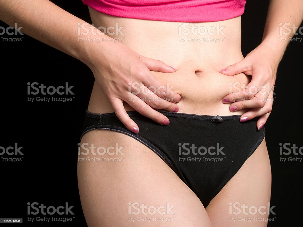 Woman pinches her fat royalty-free stock photo