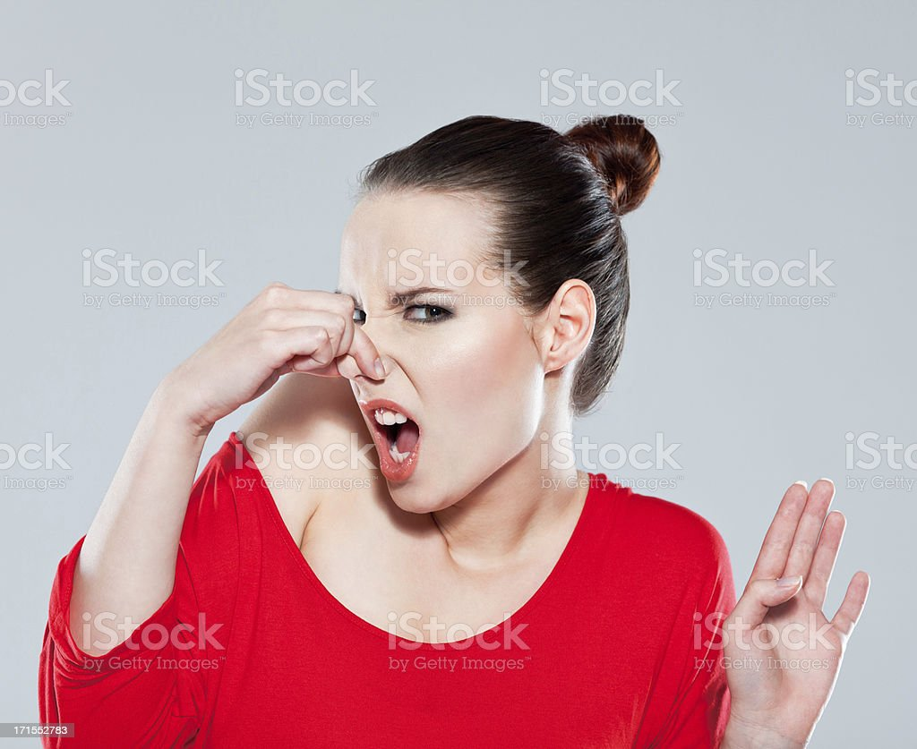 Woman pinches nose stock photo
