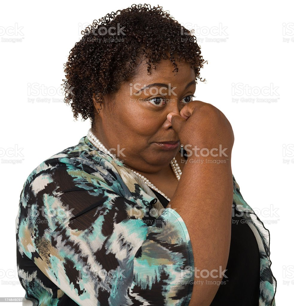 Woman Pinching Her Nose stock photo