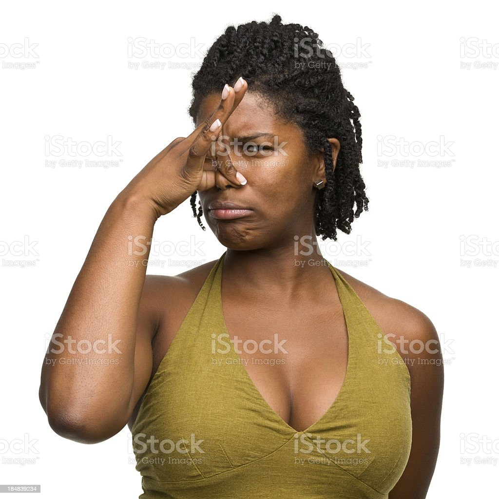 Woman Pinching Nose in Disgust stock photo