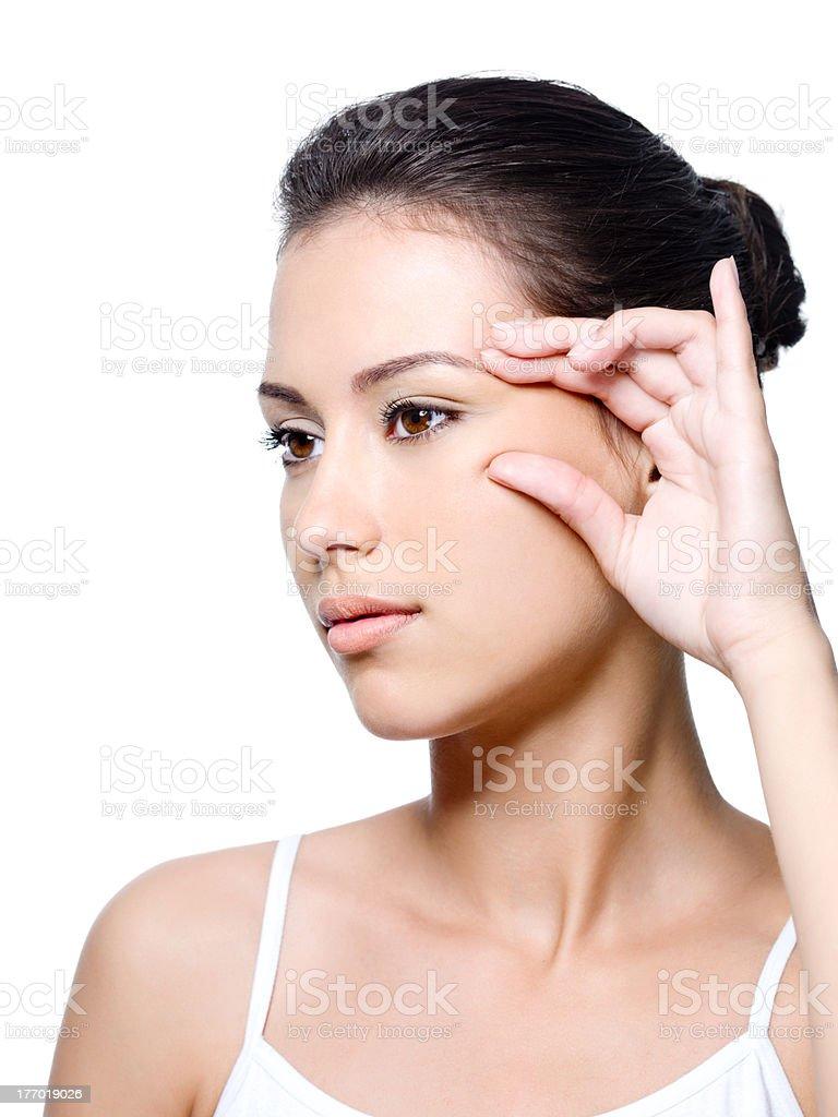 Woman pinching skin near her eye stock photo