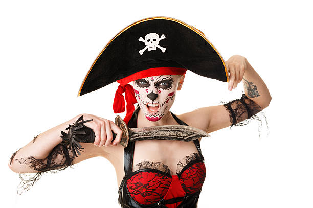 woman pirate with a sword. costume for halloween - swashbuckler stock photos and pictures