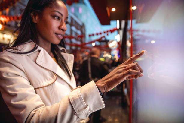 woman placing an order using a touch screen - interactivity stock photos and pictures
