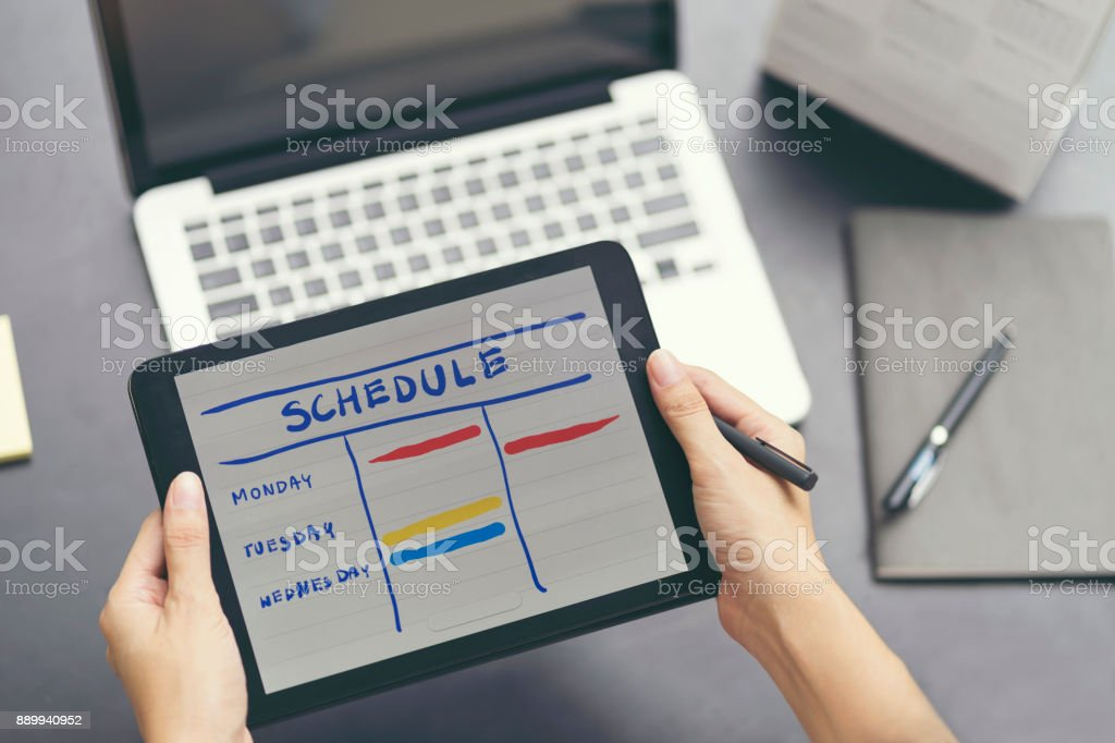 Woman planning agenda and schedule using calendar event planner. Woman hands using plan to vacation on laptop computer. Calender planner organization management remind concept. stock photo