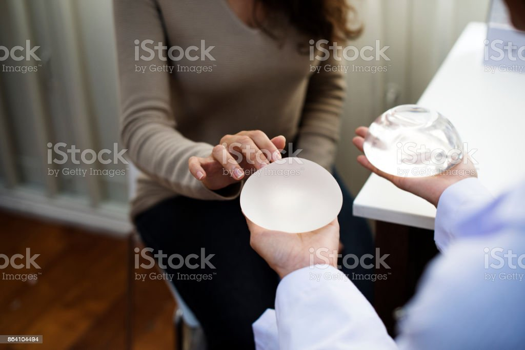 Woman planning to have a breast implant stock photo