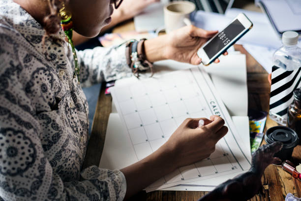 woman planning writing note on calendar - calendar stock photos and pictures